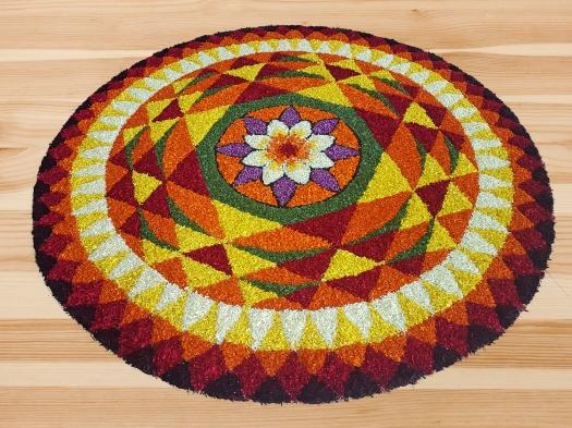 Indian traditional floral Boho art design on wooden floor